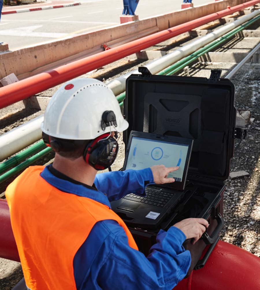 a man working with vidisco ndt solution system